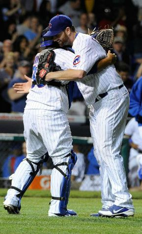 xxxxx hugs Dioner xxx after his first complete-game win (MLB.com)