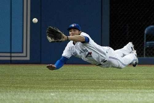 Kevin Pillar makes diving catch of a ball hit by Boston Red Sox' Jonny Gomes during the sixth inning on 8/14/2013 (AP Photo/The Canadian Press, Nathan Denette)