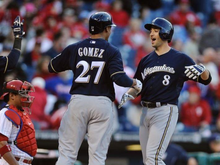 Ryan xxx Braun celebrates the last of three HRs Tuesday with Carlos xxx Gomez. (AP Photo/Michael xxx Perez)