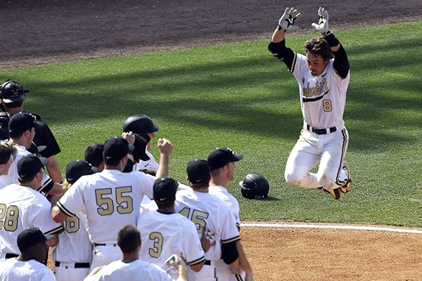 Rhett Wiseman celebrates after hitting a walk-off home run for Vanderbilt in 2015